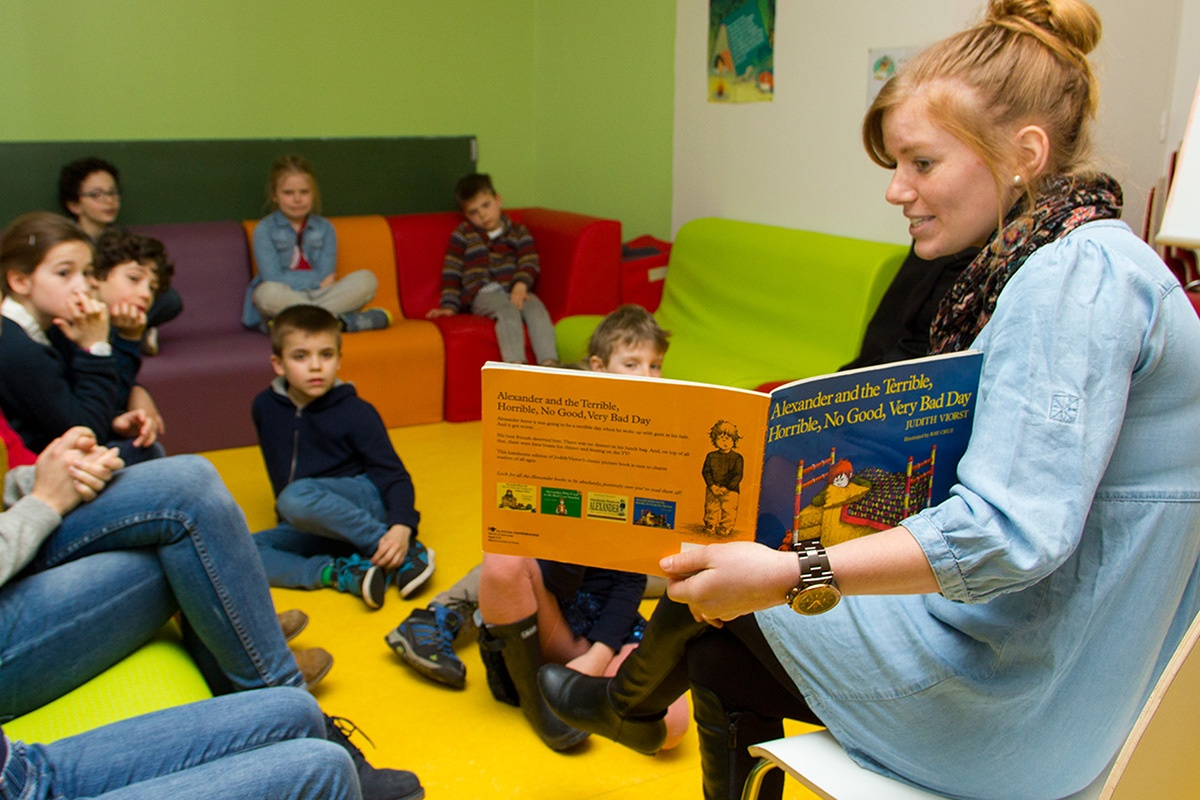 Megan reading a story to a bilingual group